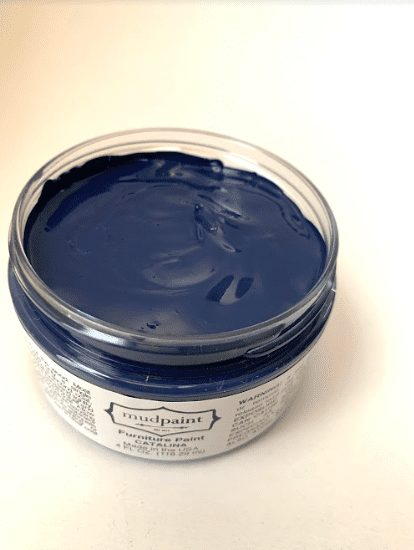 open container of royal blue furniture paint