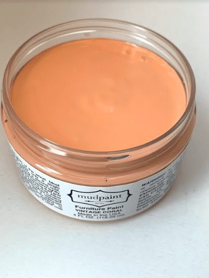 open container of orange clay furniture paint color