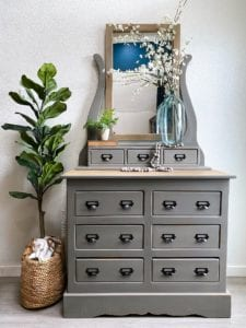 large dresser  with mirror and plant painted in gray brown stone clay furniture paint