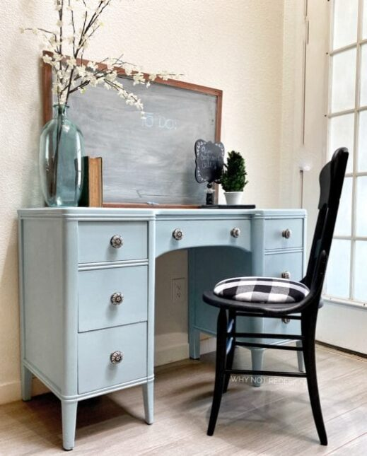 bureau dresser painted in light blue Mudpaint clay furniture paint with black chair
