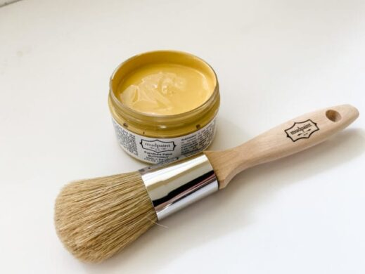 open container of butternut yellow clay furniture paint with mudpaint logo natural bristle brush