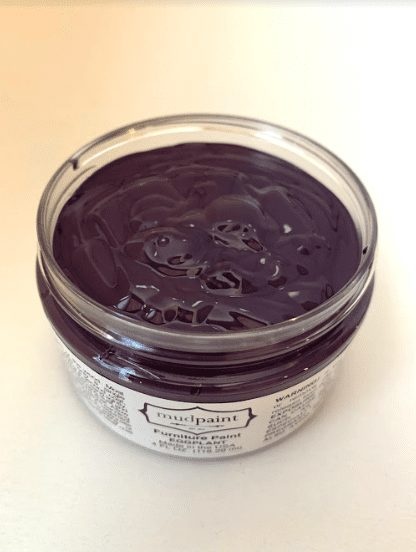 open container of eggplant clay furniture paint