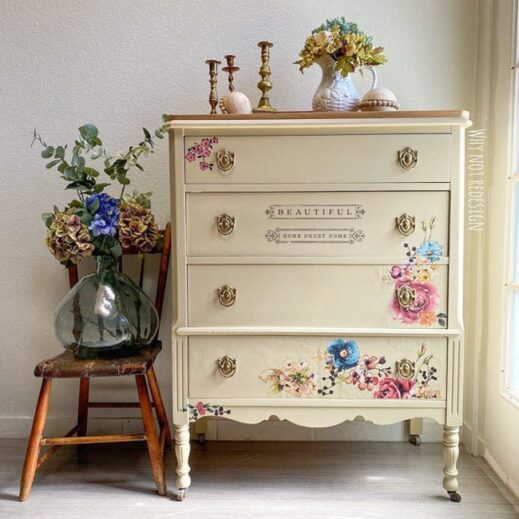 dresser painted in tan clay furntiure paint with flowers and a vase resting beside it