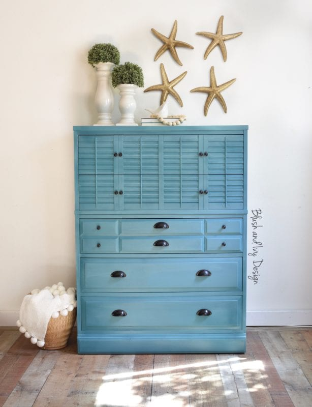 a dresser staged in a corner with teal mudpaint clay furniture paint color