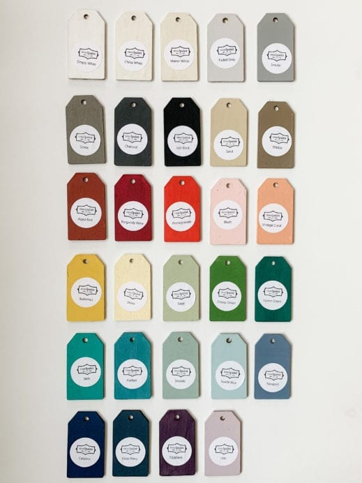 Various colors of small wooden tag hand painted with clay furniture paint