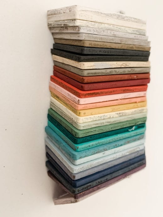 Stack of small wooden tag hand painted with clay furniture paint