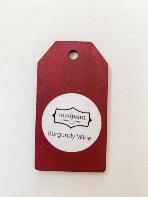 Small wooden tag hand painted with burgundy red clay furniture paint