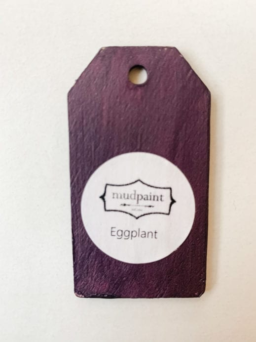 Small wooden tag hand painted with deep purple clay furniture paint