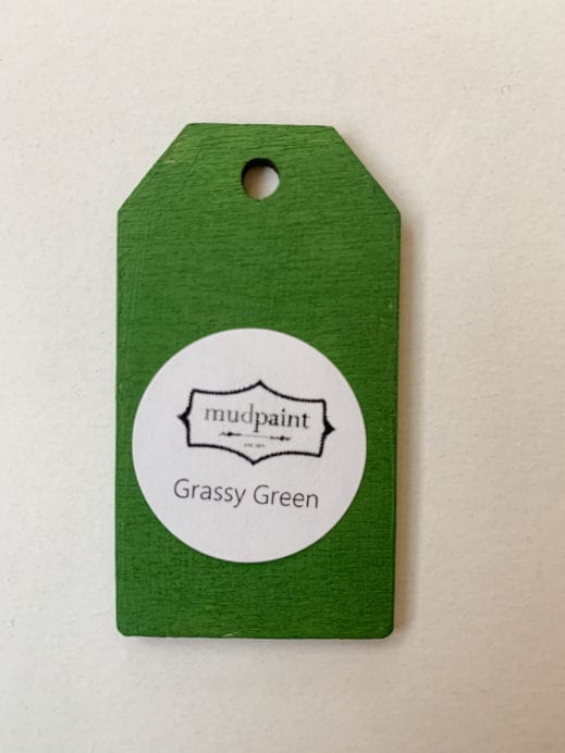 Small wooden tag hand painted with bright green clay furniture paint