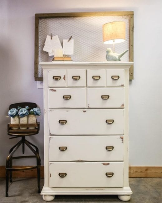 large dresser and mirror frame painted with creamy white clay furniture paint