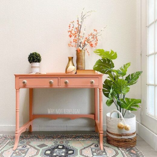 very small desk painted in orange clay furniture paint