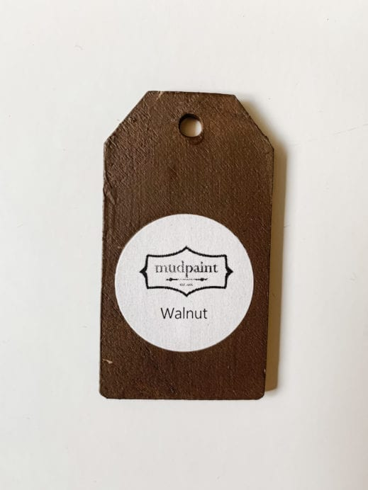 Small wooden tag hand painted with dark brown clay furniture paint