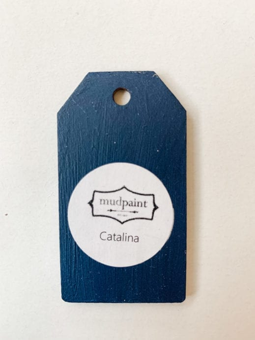 Small wooden tag hand painted with royal blue clay furniture paint