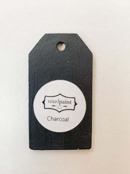 Small wooden tag hand painted with dark gray clay furniture paint