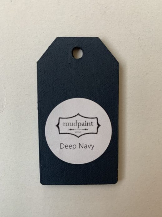 Small wooden tag hand painted with dark navy clay furniture paint