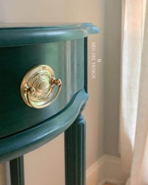 close up image of a very small desk painted in dark green clay furniture paint