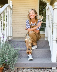 company owner and founder of Mudpaint clay furniture paint sitting on a front porch