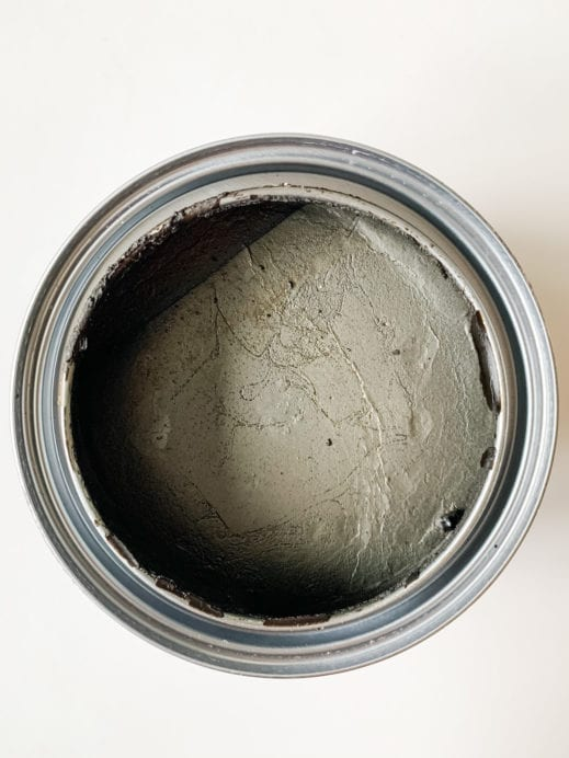 top view of open container with MudPaint dark finishing wax for furniture