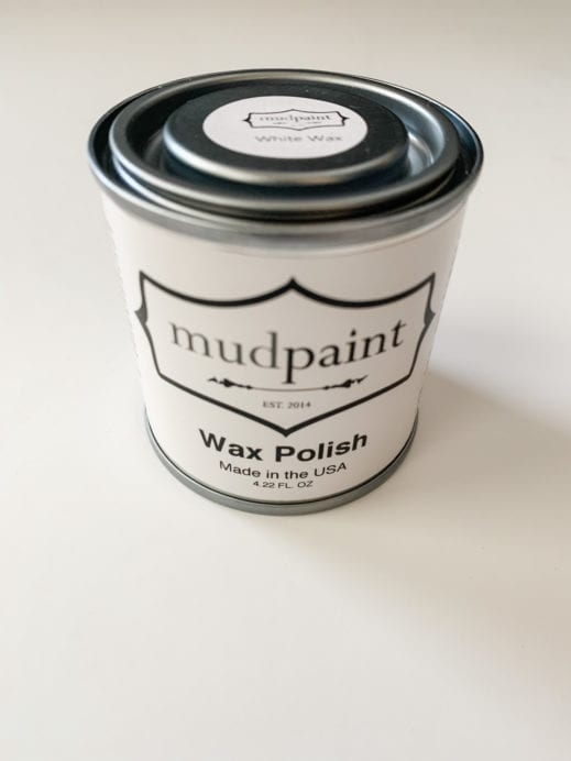 Container of mudpaint white liming wax on a white backdrop