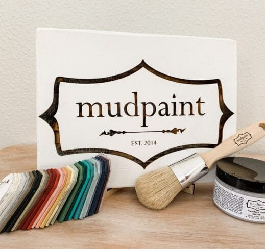 mudpaint clay furniture paint branded sign sitting on an easel with a white backdrop