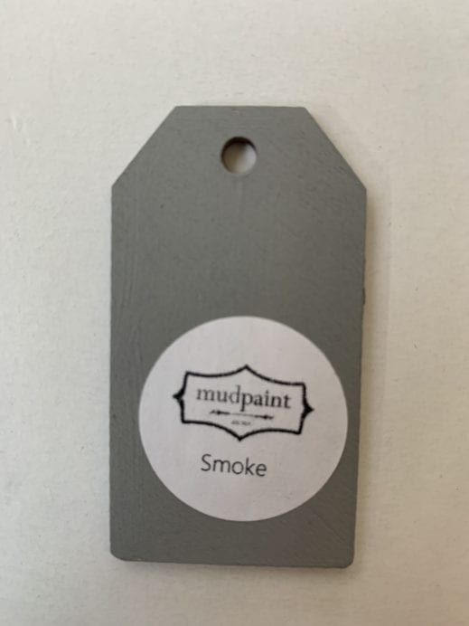 Small wooden tag hand painted with gray clay furniture paint
