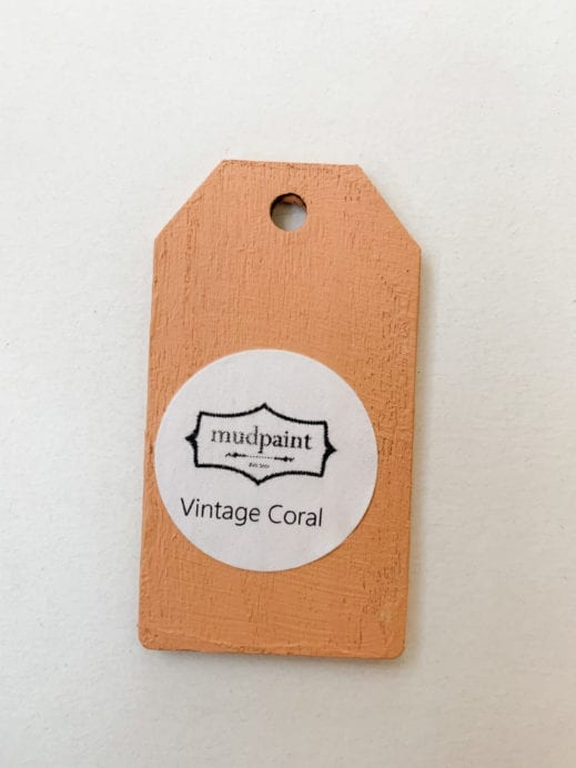 Small wooden tag hand painted with orange clay furniture paint