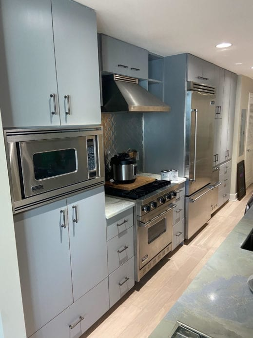 Kitchen cabinet remodel painted with light gray clay furniture paint