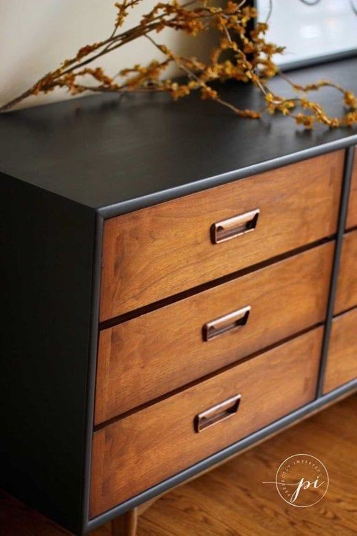 angled view of a large breakfast hutch painted with just black clay furniture paint