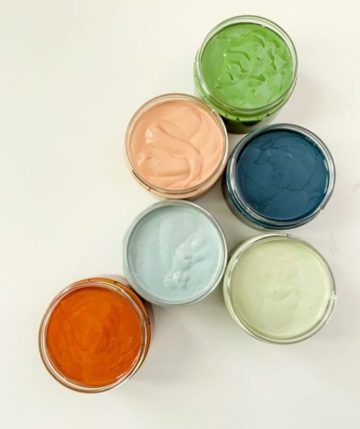 several open containers of clay furniture paint colors