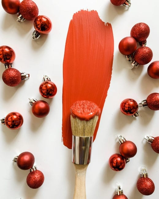 painted brush with MudPaint pomegranate red clay furniture paint with seasonal ornaments