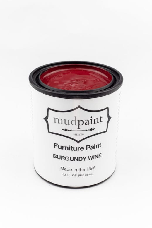 quart container of burgundy red clay furniture paint