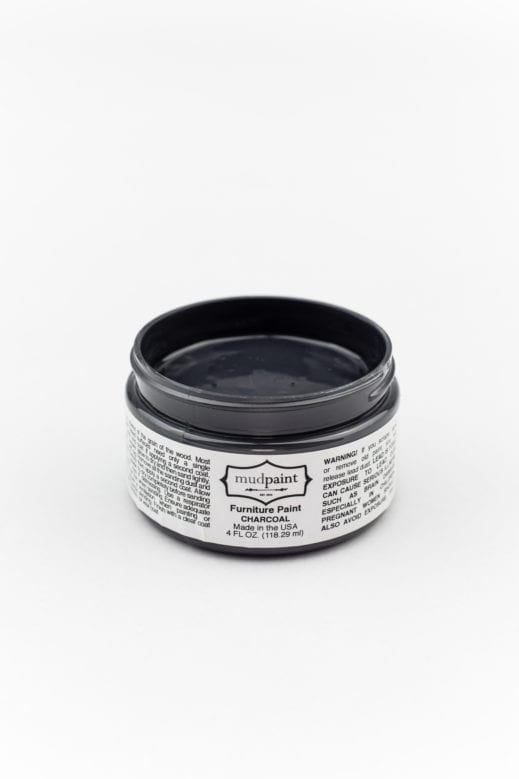 container of dark gray clay furniture paint