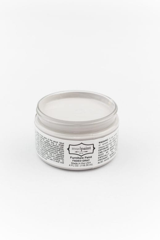 sample container of light gray clay furniture paint