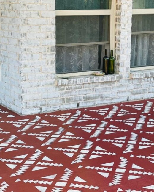 concrete floor painted in dark red clay furniture paint by MudPaint